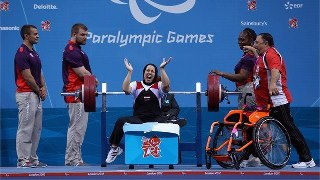 Photo: Fatma Omar of Egypt celebrates a world record lift in the Women's 56kg Powerlifting on Day 4 of the London 2012 Paralympic Games at ExCe (Getty Images)