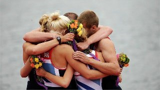 Photo: The Great Britain Mixed Coxed Four Rowing team hug each other in celebration during the Victory Ceremony after winning gold on Day 4 of the London 2012 Paralympic Games at Eton Dorney (Getty Images)