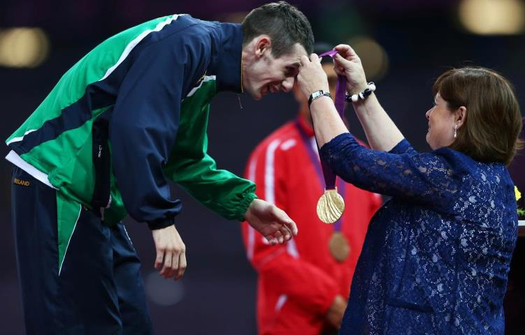 Photo: How proud would you be to be presented with your gold medal by your mum? That's what Michael McKillop (IRE) got to experience tonight with his mum Catherine! http://l2012.cm/REE7i4