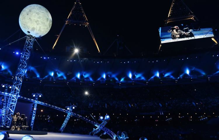 Photo: It's great to see Prof. Stephen Hawking - perhaps the world's most brilliant physicist - onstage below 'the moon' at the Paralympic Games Opening Ceremony http://l2012.cm/OvOsey