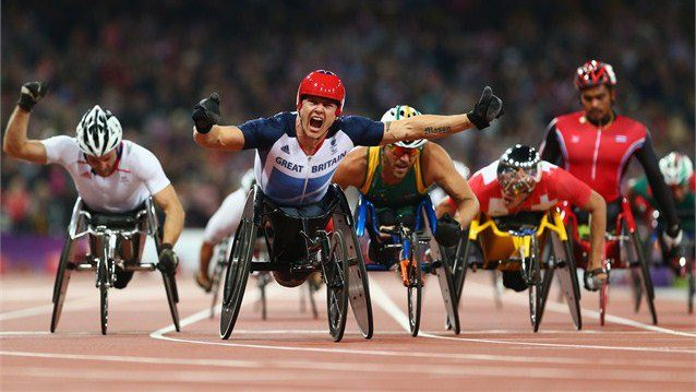 Photo: David Weir of Great Britain celebrates as he wins gold ahead of silver medallist Kurt Fearnley of Australia (C) and bronze medallist Julien Casoli of France (L) in the Men's 5000m - T54 (Getty Images)