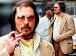 I'm not Batman: Christian Bale was spotted on the New York City set of American Hustle on Saturday in full 1970s wardrobe