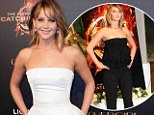 Day-to-night: Jennifer Lawrence went from black to white ensembles to promote her film The Hunger Games: Catching Fire at Cannes Film Festival in France on Saturday