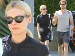 Picking up the paper: Diane Kruger and boyfriend Joshua Jackson stopped to get a newspaper on Sunday as they returned to their Los Angeles home after lunch