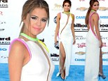 Dressed to impress! Selena Gomez flashes plenty of flesh in a futuristic white and neon gown... as she prepares to be reunited with ex Justin Bieber at 2013 Billboard Awards