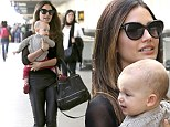 Rocker mama! Lily Aldridge dons leather pants and leopard print flats for travel day with adorable daughter Dixie