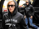 Under the hood! Madonna tries to stay incognito as she takes her younger beau and her children to a Kabbalah service
