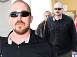 Buzz cut: Christian Bale and his family arrived at Los Angeles International Airport on Sunday with the actor sporting a shaved head after filming American Hustle in New York City