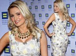 Back and better than ever! Holly Madison puts her post baby curves on full display as she slinks down the red carpet in a floral print shift dress