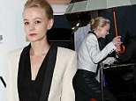 Ahoy sailor! Carey Mulligan takes shelter under an umbrella on a rainy night in Cannes as she parties on a yacht