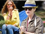 Soccer moms unite! Reese Witherspoon and Heidi Klum are proud parents as they cheer on their children at football match
