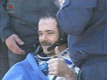 Safe: Canadian astronaut Chris Hadfield gives a thumbs-up after a successful parachute landing in Kazakhstan on Tuesday morning