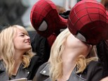 Kisses! Emma Stone, left, and Andrew Garfield, right, locked lips on set of The Amazing Spider-Man 2 in New York City on Saturday