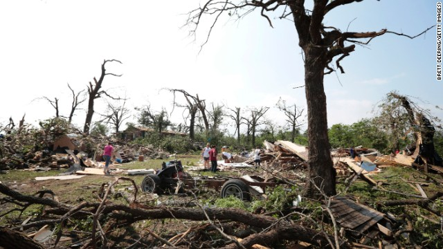 Tom and Ronda Clark get help with cleanup on May 20, after their property near Shawnee, Oklahoma, was damaged by a tornado the day before.