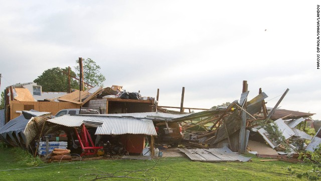 A home in Shawnee, Oklahoma, sits in ruin after being hit by a tornado on Sunday, May 19. Two people have been confirmed dead from the storms as severe weather continues to threaten the Midwest on Monday.