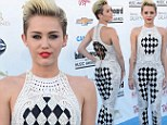 A doily disaster! Miley Cyrus slips into a black and cream crochet jumpsuit at 2013 Billboard Music Awards... and still continues to wear her engagement ring