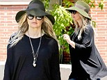 Fergie ditches the heels and flatters her burgeoning baby bump in a billowing blouse as she steps out for Sunday sermon