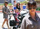 Kourtney Kardashian recycles her favourite gladiator sandals for day out with her ever-so-trendy family
