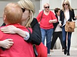 Sweet moment: Emma Stone offers a tender smooch and a hug to her mother Krista while on a stroll through the Big Apple