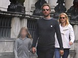 Quality time: Gwyneth Paltrow and Chris Martin enjoy a rare family day out in London on Sunday