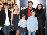 Keep The Faith: Jon Bon Jovi, pictured in 2011 with his whole family, revealed his lowest point as a father came when his daughter had a heroine overdose