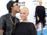 Licking good! Amber Rose's scalp receives an odd display of affection from Wiz Khalifa at 2013 Billboard Music Awards