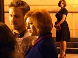 Steering the ship suits him! Ryan Gosling still manages to look suave even behind the camera, as he directs Christina Hendricks and Iain De Caestecker in his new film