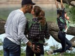 Love blooms! Tom Brady scores a kiss from Gisele Bundchen during a family frolic in a Boston park