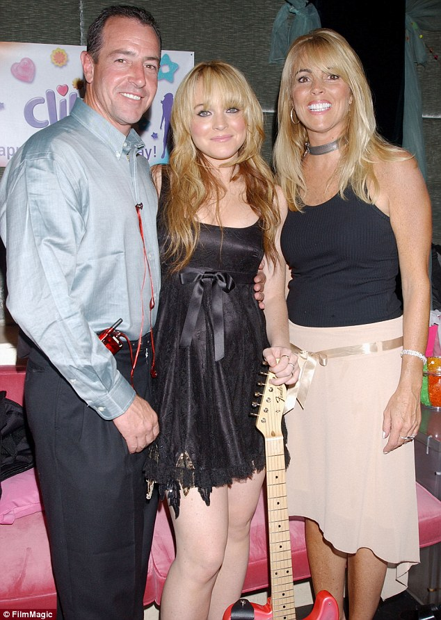 Family feud: The couple, pictured in 2003 with daughter Lindsay, divorced in 2007 after a 22-year marriage