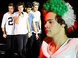 Not such a Styles-ish look! Harry covers his famous locks with a curly Italian flag wig as One Direction perform in Verona