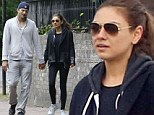 Mila Kunis and Ashton Kutcher enjoy some alone time on romantic stroll in Hampstead... a day after meeting the parents