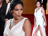 Doing an Eva! Rosario Dawson accidentally flashes her underwear as she climbs the Cannes stairs just days after Longoria exposes all