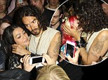 Don't mind if I do: Russell Brand enjoys the perks of his fame as he is mobbed by female fans and even sneaks a kiss