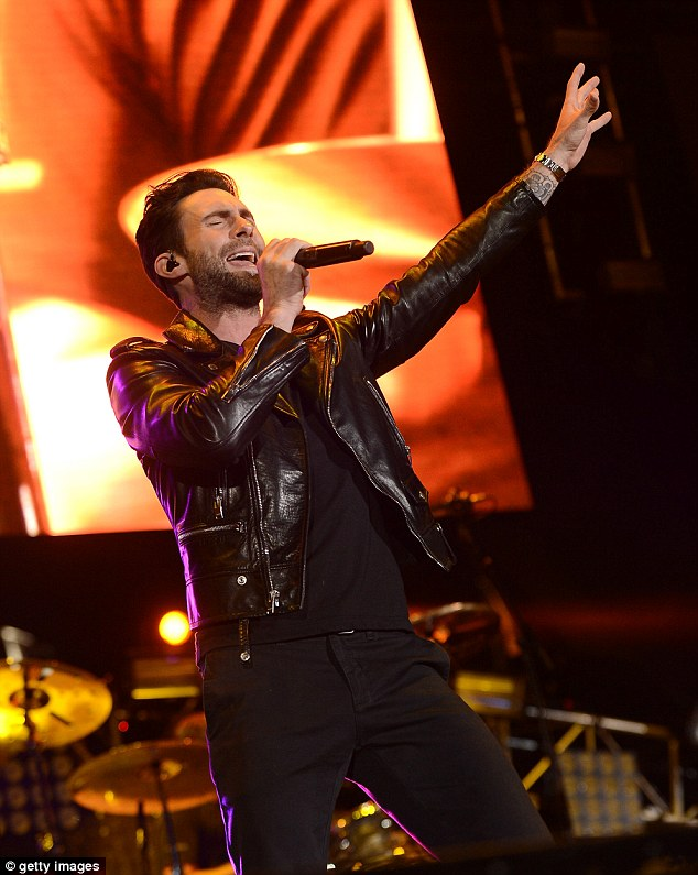 Reaching out: Adam Levine unleashed his vocal power during a gut rending rendition for the packed house