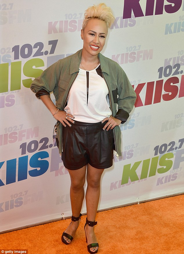 Bouffant: Scottish singer Emeli Sande showed off her blonde New Wave pompadour as she pulled off a pair of daring leather shorts