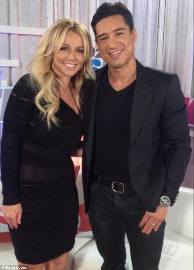 Cheek-to-cheek: Mario Lopez got in an impromptu snap with Britney backstage