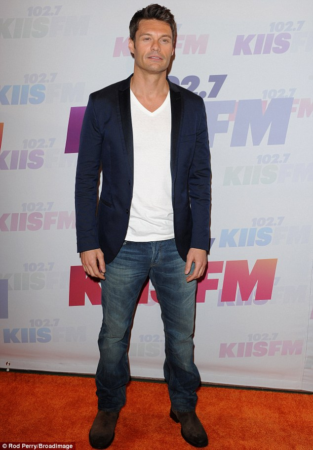 Co-host: Ryan Seacrest arrived early as well sporting a conservative white V-neck and sports coat