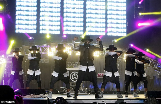 Smooth move: Black Eyed Peas singer will.i.am worked through some choreography with a troupe of uniformed dancers