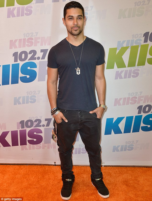 Smouldering: Actor Wilmer Valderrama donned a dog-tag laden silver chain beaded bracelets for his day of rocking out