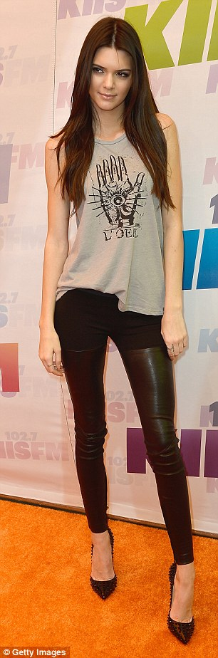 Ready to rock: Kendall Jenner sported a punk themed outfit as she attended with her younger sister Kylie
