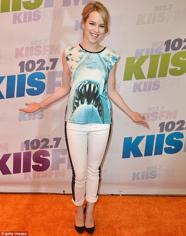 Good luck charm: Disney Channel star Bridgit Mendler was all-smiles as she wore an incongruous Jaws T-shirt