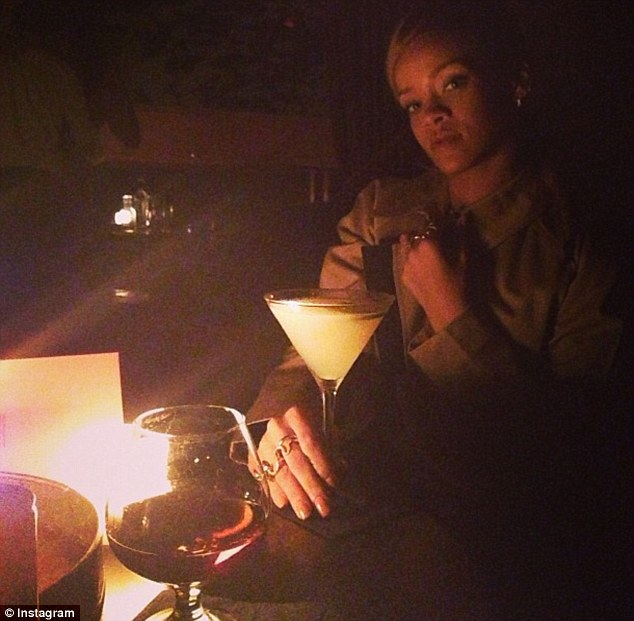 This drink is NOT for you: Rihanna shared a lonesome snap of herself on Friday night with a searing caption aimed at her ex Chris Brown