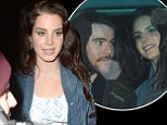 That make-up is eye-catching! Lana Del Rey's boyfriend Barrie-James O¿Neill gazes at her in awe as couple leave her concert