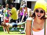 So bright! Leighton Meester dressed in rainbow gear to film Life Partner at the Long Beach Gay Pride Parade in Los Angeles, California on Sunday
