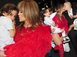 Happy families: Jennifer Lopez shares a tender moment with boyfriend Casper Smart and her twins at the 2013 Billboard Music Awards