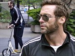 Wolverine doesn't walk: Hugh Jackman cruises around NYC on a scooter