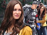 Her frown turned upside down! Megan Fox is a flirty girl on set with Teenage Mutant Ninja Turtle co-star Alan Ritchson