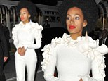 She's blinding! Solange Knowles teams a dazzling bright white jumpsuit with bold red lips after performing at a party in Cannes