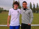 Still learning: Alex Oxlade-Chamberlain returned to his former school to present current student Jasper Clow with new Nike England home kt 2013. Jasper was surprised to be chosen to unveil #theshirt