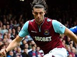 Crocked: Carroll has ended his loan spell with West Ham but will now miss England's friendlies